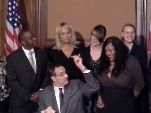 This is a sort of absurd picture of DC Mayor Vincent Gray handing me a pen at the Deoni Jones Birth Certificate Equality Amendment Act signing ceremony. I think Julius Agers took the picture.